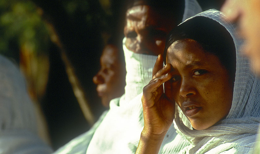 Ethiopian pilgrims in their traditional white robes wait outside this historic church for the Sunday serviceNikon F5, 180mm, Fuji Velvia 100