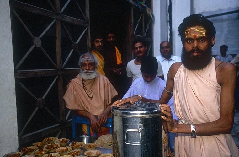 Shankaracharya devotees at the Bhuma Niketan ashram prepare to serve breakfast to hundreds of saffron-robed saints during a melaNikon F5, 17-35mm, Fuji Velvia 100