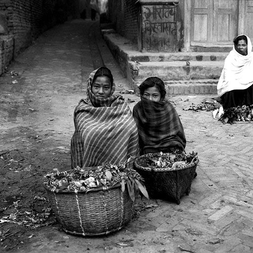 Wrapped up against the late autumn chill, these girls are selling their vegetable produce at the daily dawn streetmarketBronica ETRS, 50mm, Ilford HP5 @ 800ASA