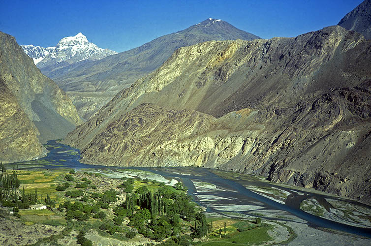 The Murgab is the major tributary of the Ab-i-Panj, more famously known in the west as the Oxus, which drains a large part of the Pamirs. This picture is of the village of Barchedev, just a day's walk from the huge rubble dam that holds back Sarezkoe Lake. See picture 43 in this gallery.Olympus AF Twin, 35mm, Kodachrome