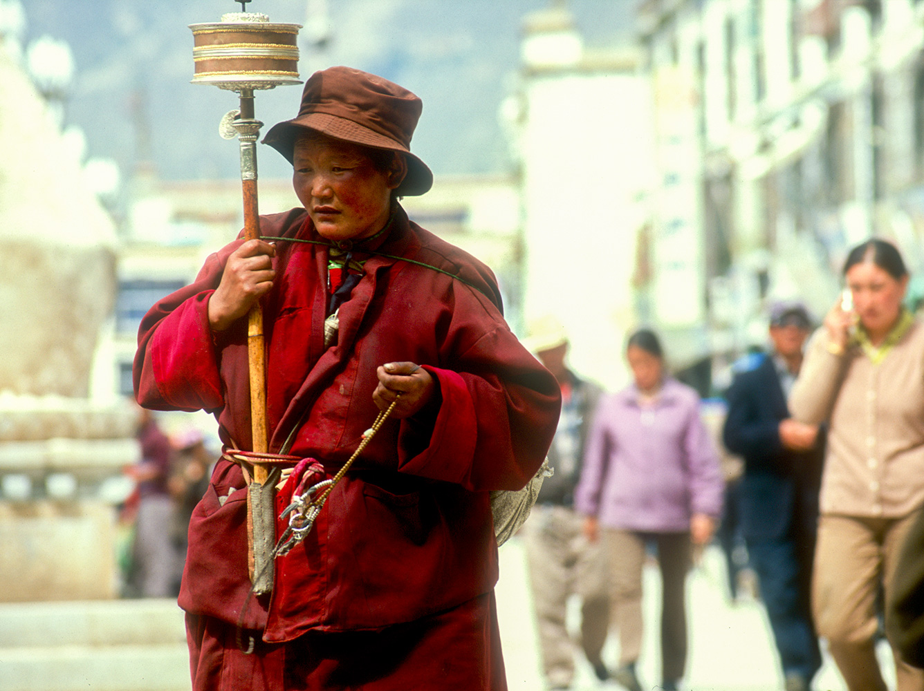 All day on this holy route, a constand stream of shuffling, chanting people circle the Jokhang. This is life as meditation....Nikon F5, 180mm, Fuji Velvia 100