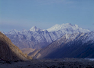 A telephoto of the west face, taken from Yashpirt on the Batura glacier. This is a view east across the Hunza valley towards Shimshal, and Kanjut Sar can be seen over the flank of Disteghil Sar at the far right.
