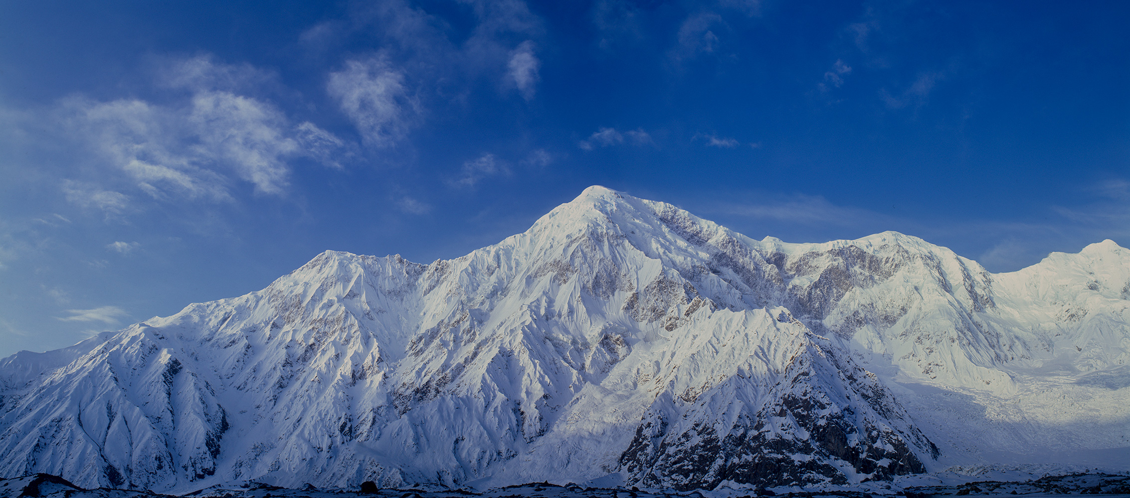 A panorama of three medium format images, taken looking south across the Batura glacier from Put Mahal (Fatimahel on some maps). Taken in May 1992 with spring snow still covering the mountains. Awesome!