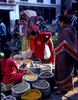 At daw, before the hordes of tourists have risen from their beds, the ordinary folk of Kathmandu are out buying provisions from countless tiny markets city-wide. Much produce is grown in the immediate vicinty of the city and carried into the centre for sale every morning by the producers.Nikon FM2, 50mm, Vuji Velvia