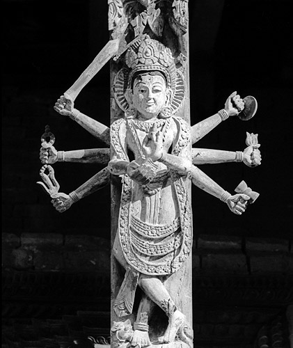 Newari artisanship on display - a wooden carved deity under a temple roof in Durbar SquareBronica ETRS, 150mm, Ilford HP5 @ 800ASA