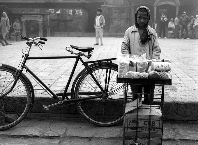 A young boy selling breadBronica ETRS, 75mm, Ilford HP5 @ 800ASA