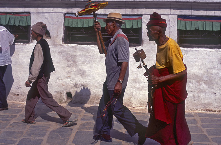 Tibetans in the shuffling, unidirectional flow of humanity that incessantly circles the great stupa.Nikon FM2, 50mm, Fuji Velvia