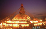 The great stupa at Bodnath, lit up with thousands of butter lamps at dusk during the festival of Mani RimduNikon FM2, 24mm, Fuji Velvia