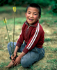 A boy with arrows druing archery practiceNikon FM2, 50mm, Fuji Velvia