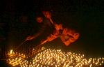 Young monks lighting butter lamps during the Mani Rimdu festivalNikon FM2, 50mm, Fuji Velvia