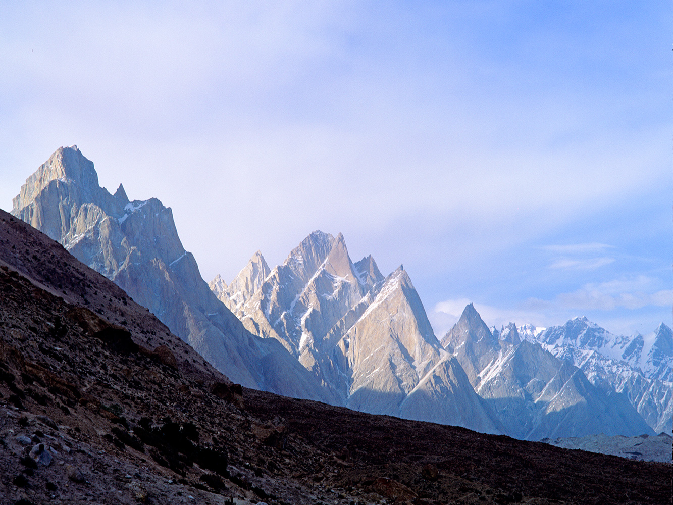 A view to the Cathedral Spires and the snout of the Baltoro glacier.