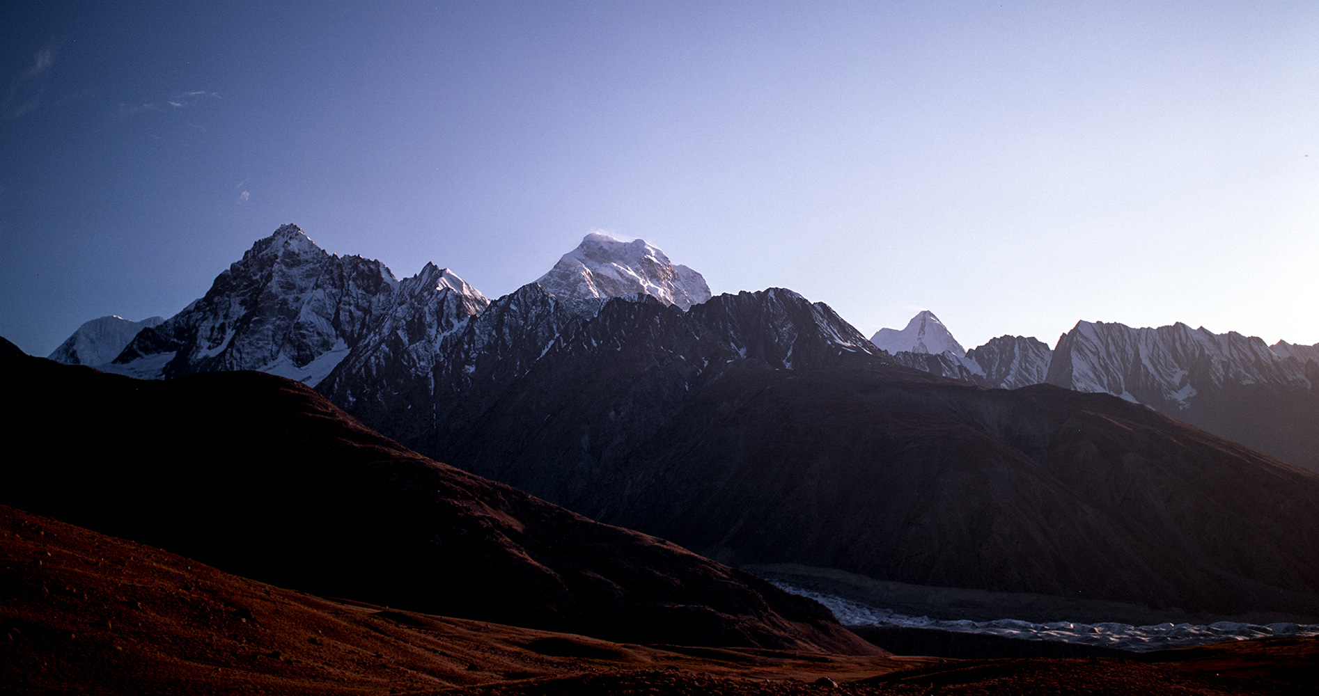 Evening light on Thui II and Koyozom from a high point above the confluence of the Chatteboi glacier and the Yarkhun valley. Chitral, NWFP, PakistanBronica ETRSi, 50mm, Fuji Velvia