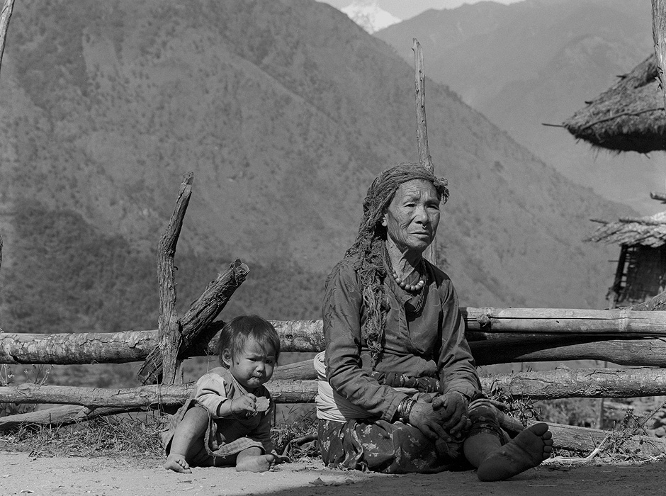 Chhetri child and grandmother Relaxing in the afternoon sunshine at Simikot, Humla