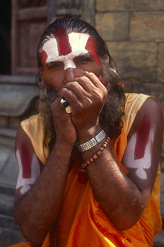 A saddhu fires up his chillum on the banks of the Bagmati river at Pasupatinath, KathmanduNikon FM2, 50mm, Fuji Velvia