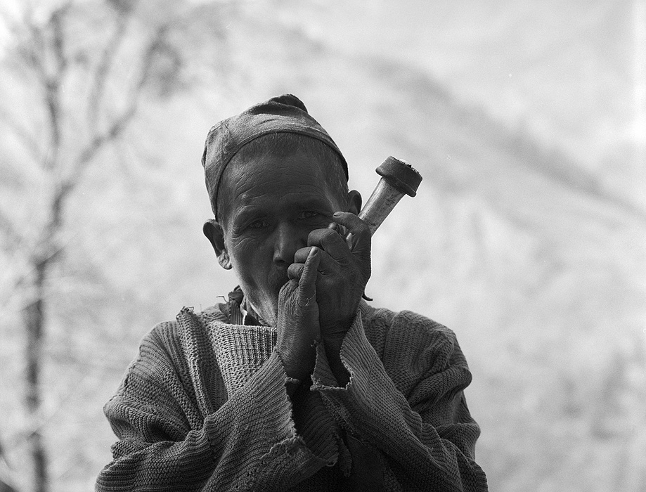A Chhetri man smoking his sulpa or chillum pipe at a chai shop below Simikot in the Humla Karnali valley, Western Nepal