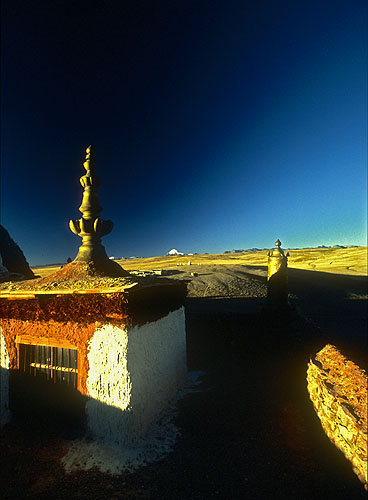 A small monastery on the shores of Manasarovar Lake, built over a cave where legend holds that the Buddhist saint Guru Rimpoche (Padmasambhava in Sanskrit - {quote}The Lotus Born{quote}) once meditated. Nikon FM2, 17-35mm, Fuji Velvia