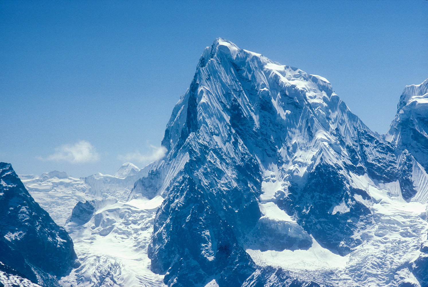 Seen from Gokyo Ri in April 1984. It was first climbed via the southwest ridge on April 22, 1982 by Vern Clevenger, Galen Rowell, John Roskelley, Bill O'Connor and Peter Hackett.Canon A1, 135mm, Kodachrome