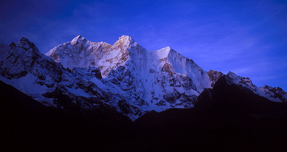 Chomolonzo at dawn from Pethang in the Kharta Valley.Nikon F5, 35mm, Fuji Velvia 100