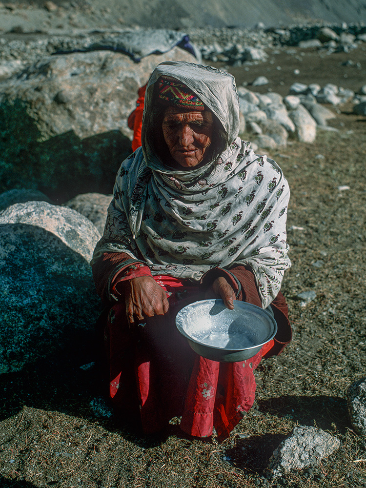 A Shimshali woman takes back the bowl in which she gave me delicious dahi (curd) to eat