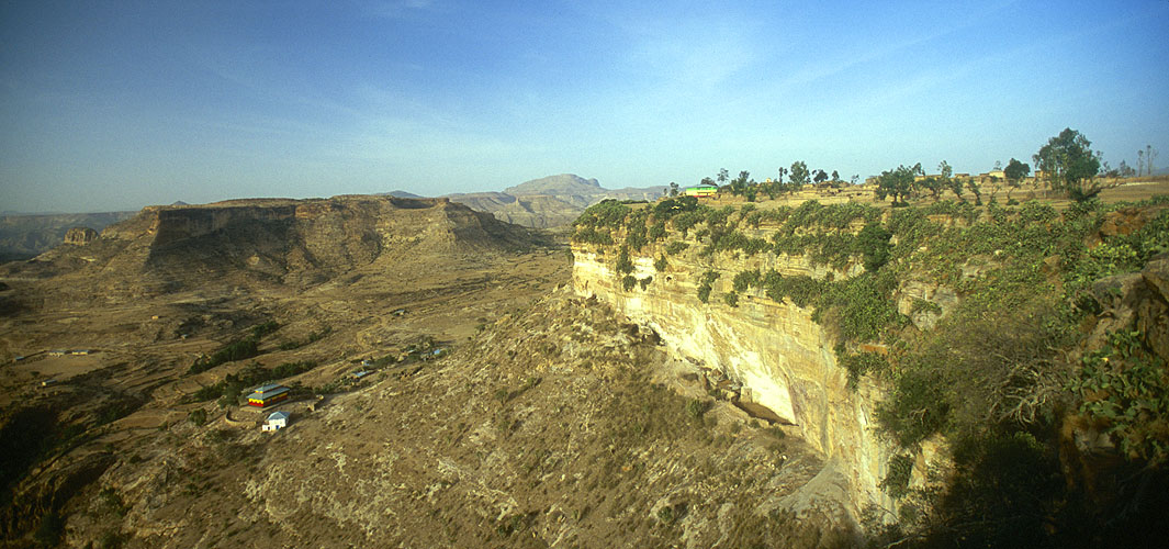 Dating from early Axumite times, this fabulous monastery in the Tigray district of Ethiopia looks out over the hills forming the border with Eritrea. It is situated atop a rocky plateau accessible only by rope up a vertical cliff. Nikon F5, 17-35mm, Fuji Velvia 100