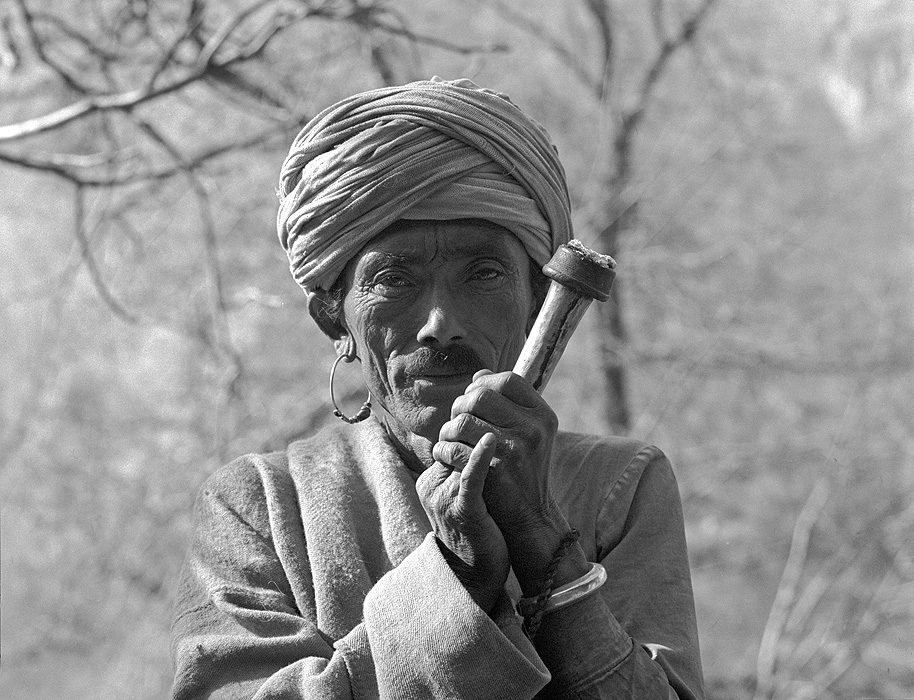 A dhami or shaman smoking his chillum - called a sulpa in Humla - at a village below Simikot in the Humla Karnali valley, far-western NepalBronica ETRSi, 70mm, Ilford HP5 @ 800ASA
