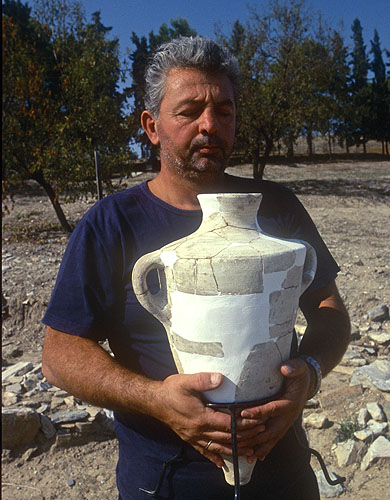 A Greek archaeologist shows one of many Bronze Age artifacts recovered during the 1997 excavationsNikon F5, 17-35mm, Fuji Velvia 100