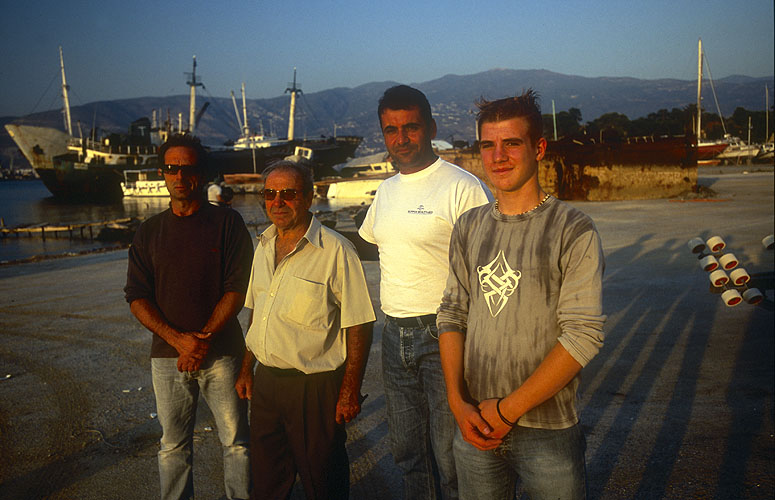These men intend to demonstrate that it is indeed possible to sail from Iolkos, through the Bosphorus and along the Black Sea coast to Georgia in exactly the same type of boat as Jason. Here they pose on the quay at Pagasae after a day's work on their project.Nikon F5, 17-35mm, Fuji Velvia 100