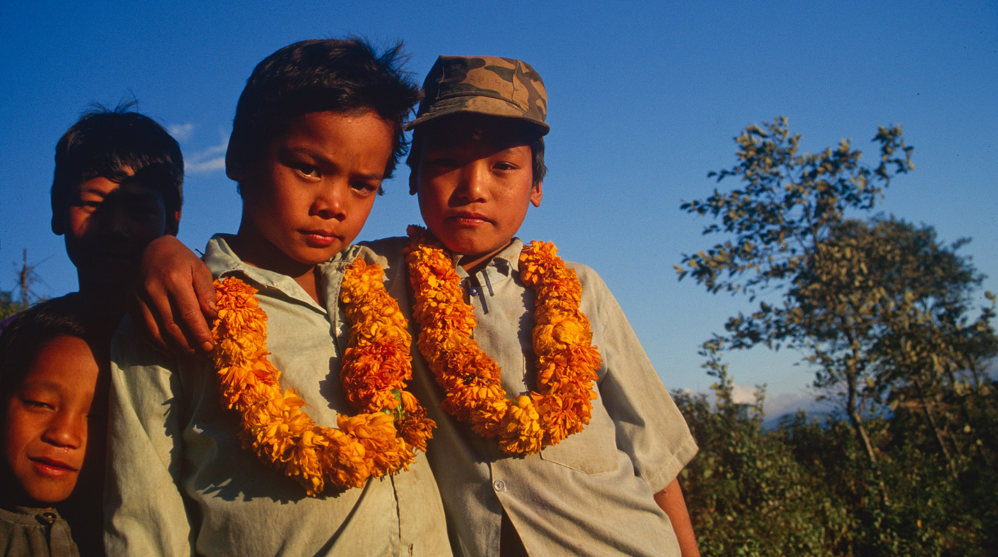 Garlanded children at this village in the Kabeli Kola valley, on the approach to the south side of Kangchendzonga.Nikon FM2, 28mm, Fuji Velvia