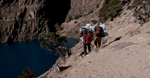 Porters on the trail north along the shores of Phoksundo Tal from Ringmo to Shey