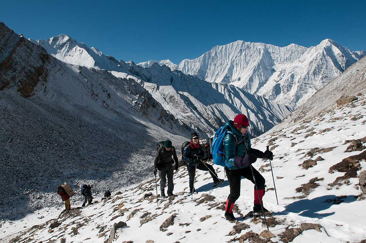 Trekkers on the final slopes, with Kanjiroba beyond