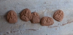 Un-fired clay Buddhas left by pilgrims