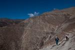Trekkers on the high traversing trail towards Saldang from Namgung, Inner Dolpo, Nepal