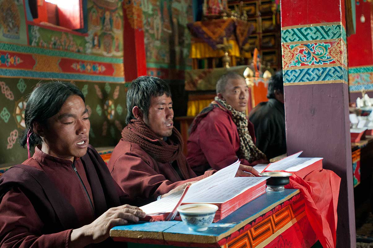 Monks chanting sutras in the main temple or labrang