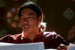 Buddhist monk chanting sutras