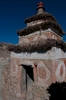 This is an archway or entrance chorten (stupa in Sanskrit), commonly found where a trail enters or leaves a village or the precincts of a monastery