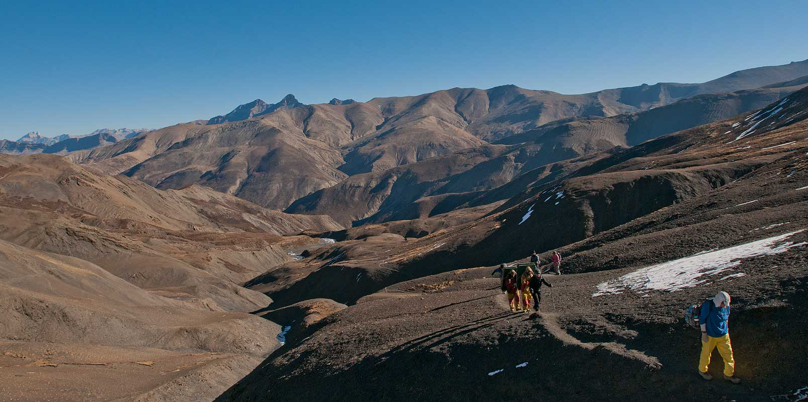 Trekkers approaching the crest of this high pass between Saldang and Dho Tarap
