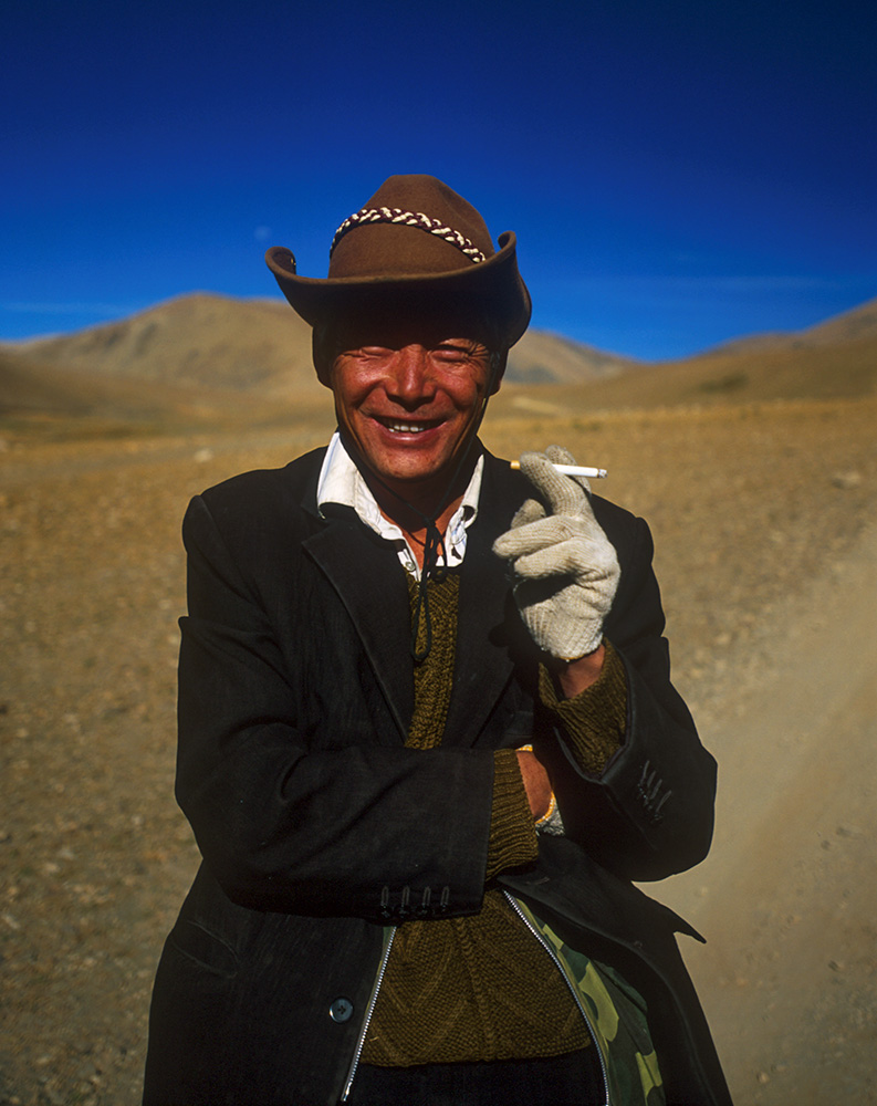 One of our drivers from Lhasa taking a break during the journey to Everest.Nikon F5, 35mm, Fuji Velvia 100