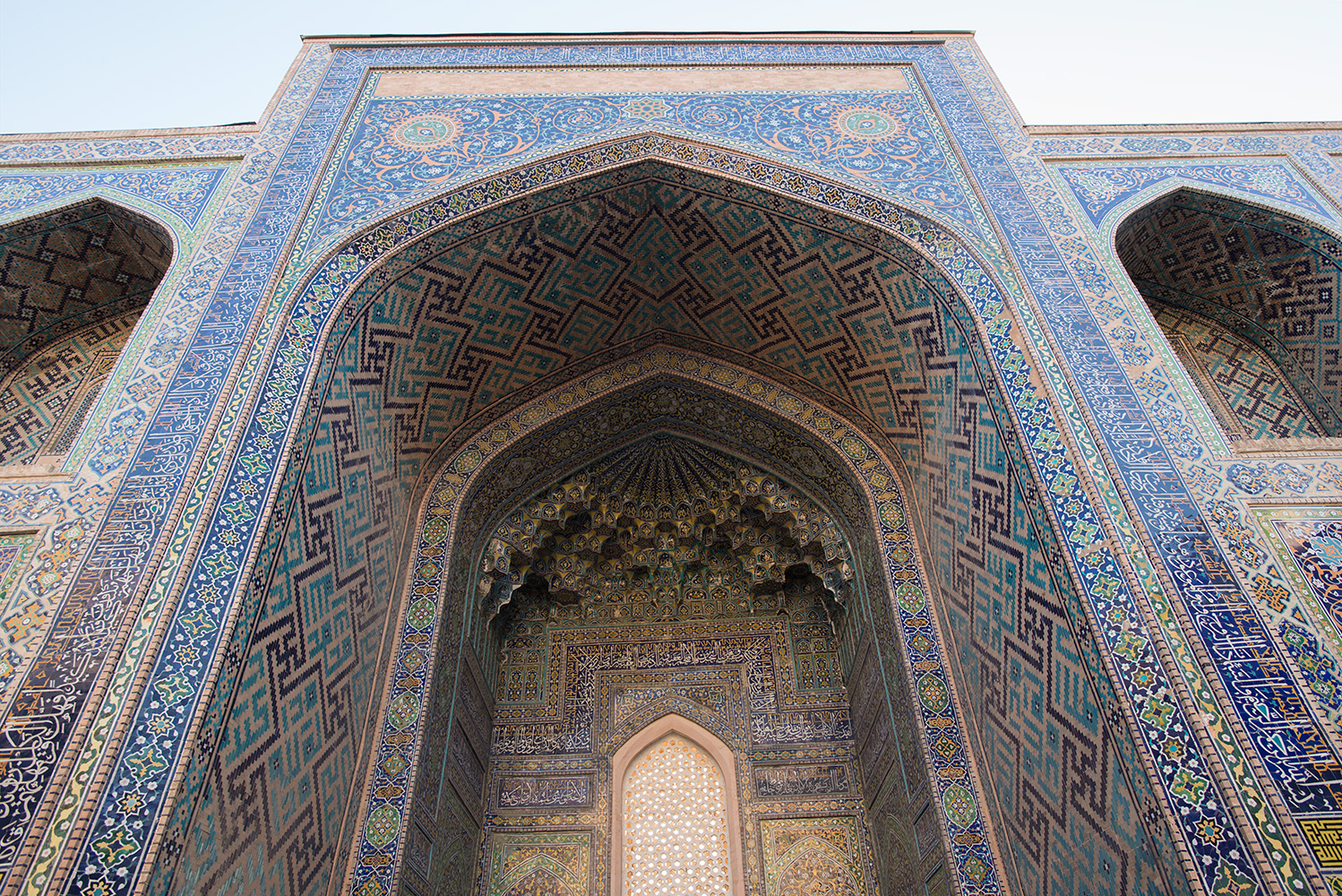 Built by Governor Yalangtush and completed in 1660, the central madrassah in the Registan square is the largest. This is the portal on the east side, flanked by two stories of hujra (rooms used for prayer / study)