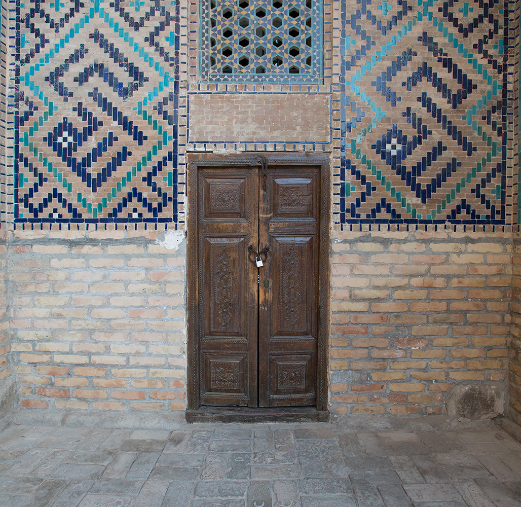 Door of a hujra cell in the courtyard