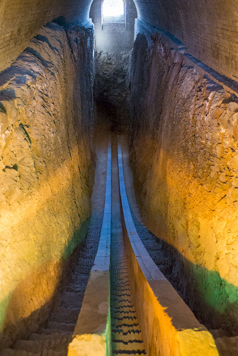 This is one of the most remarkable sites in Samarkand. Ulug Beg, grandson of Emir Timur, was certainly posessed of an enquiring mind. He was born Mohammed Taragai on 22nd March 1394 - the vernal equinox. Timur gave him the name Ulug Beg, meaning grand duke. At the age of 15 his father made him viceroy of Samarkand, and under his rule the city gained a reputation as a centre of learning. The Turkish astronomer Qazi Zadeh Rumi came there, and under his tutelage Ulug Beg discovered a passion for astronomy.From 1424-29 he had an observatory built that had no parallel anywhere on earth. Amongst many other acheivements in this field he measured the stellar year to within one minute of our present electronic calculations. His dramatic life story is worthy of a film.This is all that remains of what was once a magnificent three-story building. It is the uderground part of a giant meridian arc which the religious fanatics that destroyed the building and murdered its creator in 1449 ignored, and which the Russian archaeologist Viyatkin re-discovered in 1908.