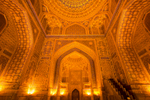 The interior at night. The amount of gold leaf is breathtaking, and gives the Madrassah its name, which means guilded