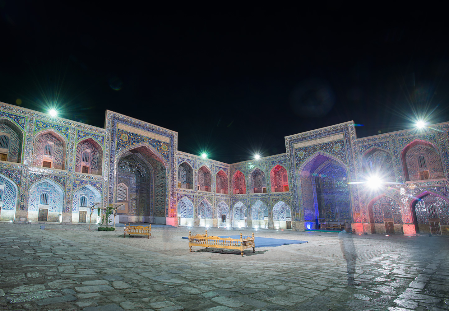 The courtyard, floodlit at night