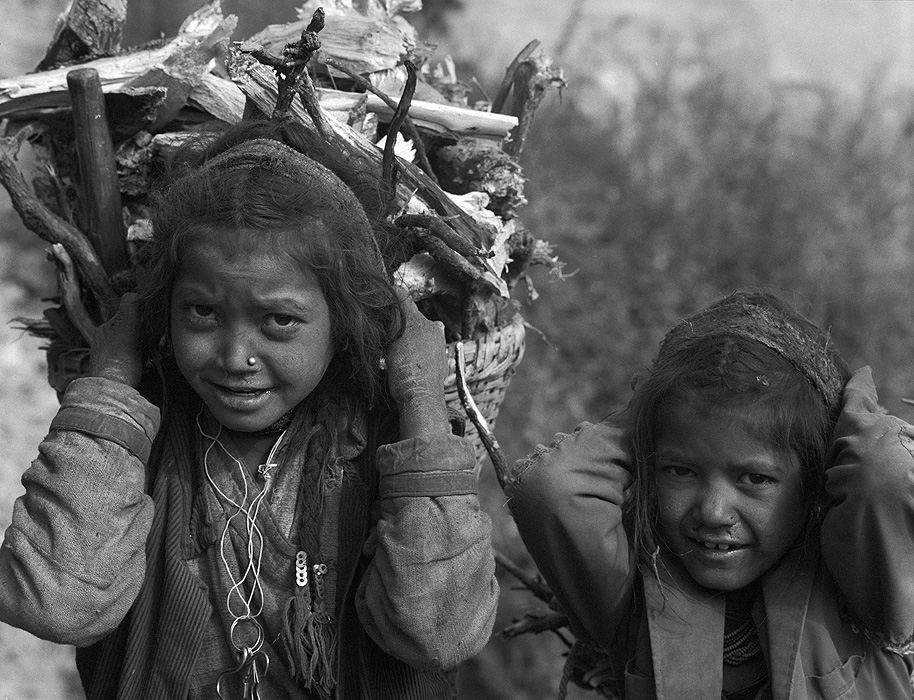 There is practically no electricity in Humla, and people need a lot of fuel for winter heating and cooking. This is carried down to the villages from above throughout the autumn months. These girls are returning to Simikot.Bronica ETRSi, 70mm, Ilford HP5 @ 800ASA