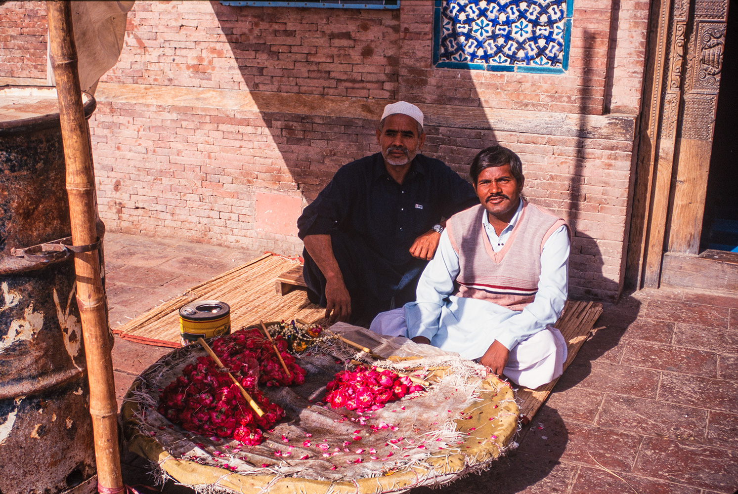 Flower sellers at the mausoleum of Sufi saint Shah Rukn-i-'AlamBronica ETRS, 75mm, Fuji Velvia