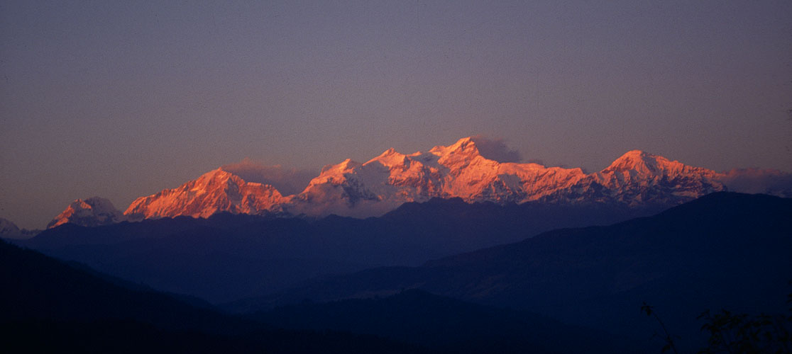 The Ghurkha Himal at sunset, from just above the town of Ghorka. On the left is Ngadi Chuli (7935m), in the centre Himal Chuli (7893m) with its long south-east ridge shaply illuminated. On the right is Bhauda Himal (6672m).Nikon FM2, 24mm, Fuji Velvia