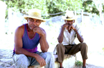 Two sugar estate workers enjoying a midday break in the shade. Hacienda Iznaga is in the Valle de los Ingenios, on the road from Trinidad to Sancti Spiritus.Nikon FM2, 24mm, Fuji Velvia