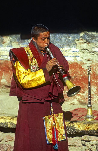 A lama blows his ceremonial horn.North-west NepalNikon FM2, 17-35mm, Fuji Velvia
