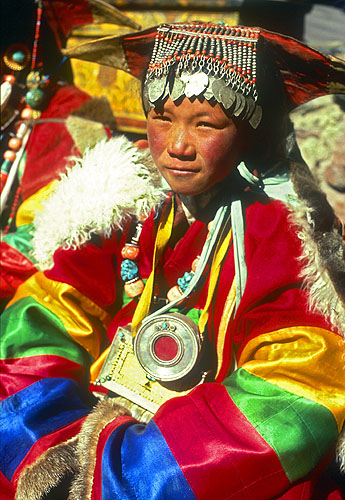 Khojar woman in her ceremonial wedding clothes. The jewelry represents much of her family's wealth, and is worn here at a festival in the monastery.North-west NepalNikon FM2, 17-35mm, Fuji Velvia