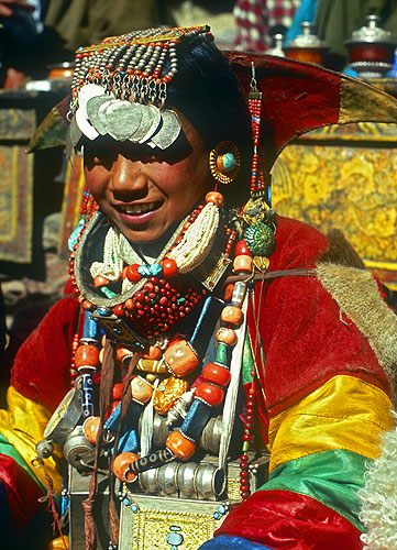 A Khojar woman in her wedding finery during a festival at the monastery.North-west Nepal.Nikon FM2, 17-35mm, Fuji Velvia 100
