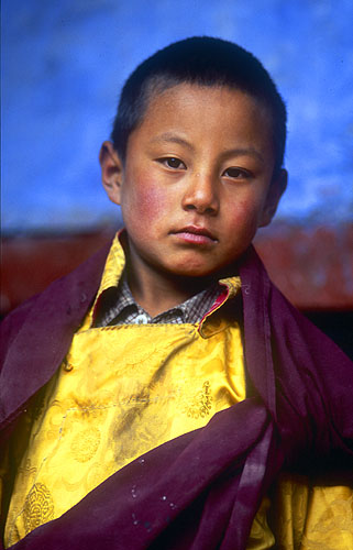 A young novice monk.North-west Nepal.Nikon FM2, 17-35mm, Fuji Velvia 100
